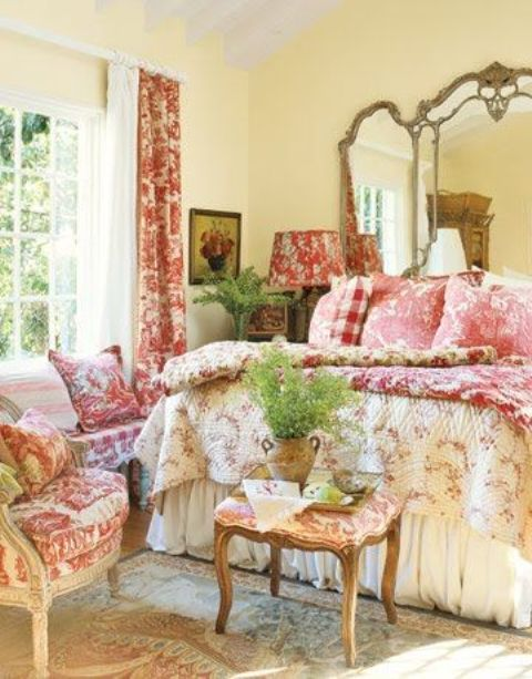 Provence-style bedroom in red, yellow, and cream