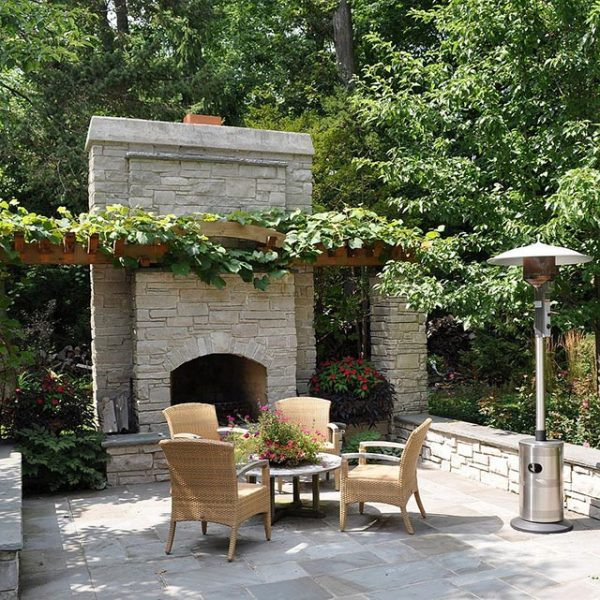 Climbing vines above outdoor fireplace in the garden #fireplace #outdoor #homedecor #garden #patio #decorhomeideas