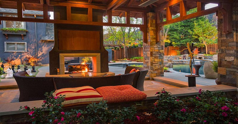 Stunning retreat patio with a fireplace