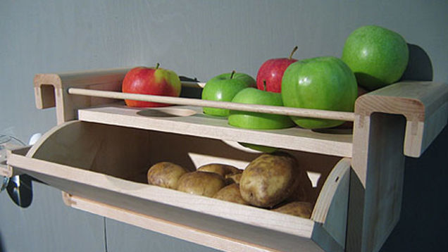 Potatoes and apples on shelves