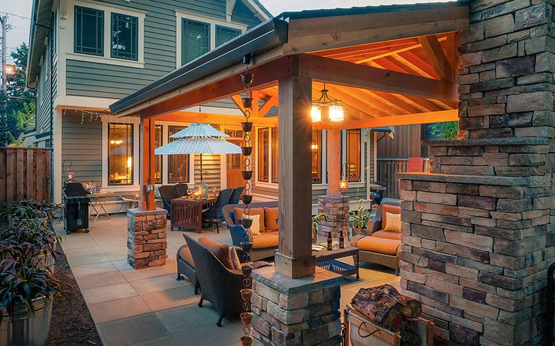 Outdoor backyard patio with stone and wood