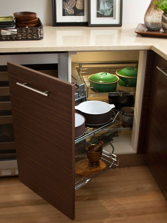 Creative kitchen storage idea with pull out door. #kitchen #storage #organization #cupboards #cabinets #shelves #decoratingideas #decorhomeideas
