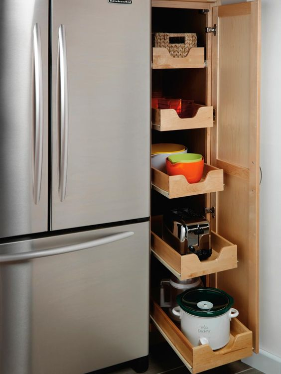 Efficient kitchen vertical storage idea with pull out drawers. #kitchen #storage #organization #cupboards #cabinets #shelves #decoratingideas #decorhomeideas #drawers