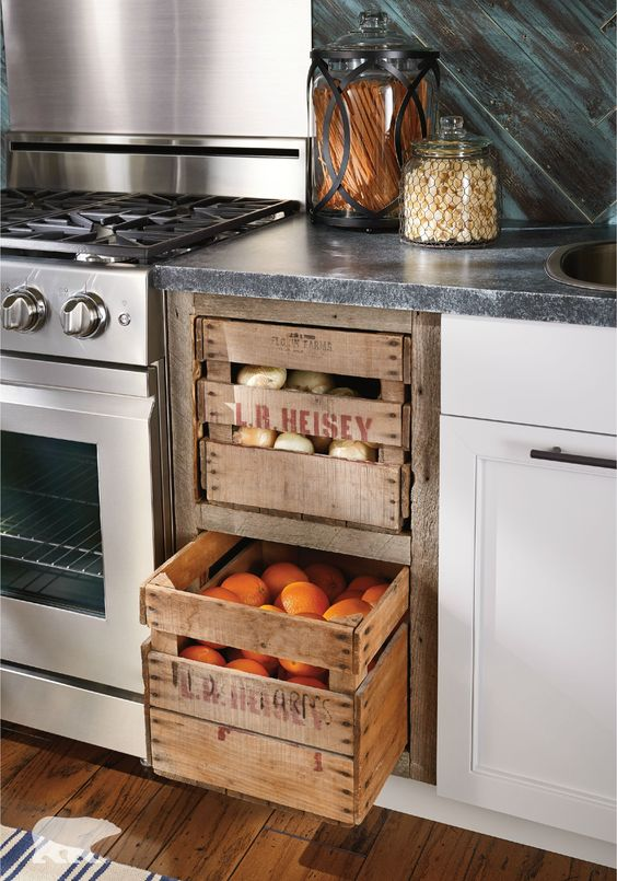 Kitchen storage idea from wooden crates for fruits and vegetables. #kitchen #storage #organization #cupboards #cabinets #decoratingideas #decorhomeideas #drawer