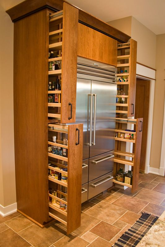 Pull out cabinet spice storage idea around the fridge. #kitchen #storage #organization #cupboards #cabinets #shelves #decoratingideas #decorhomeideas #drawer