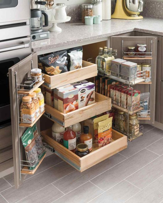 Small kitchen storage idea with pull out drawer and hangers on the doors. #kitchen #storage #organization #cupboards #cabinets #shelves #decoratingideas #decorhomeideas #drawer
