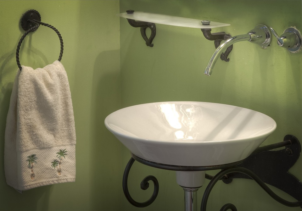 Rustic green bathroom with small sink