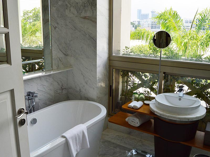 Small but luxury bathroom with oval bathtub and sink