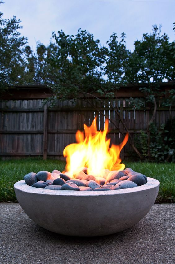 Concrete bowl fire pit idea #firepit #exterior #patio #decoratingideas #cozy #decor #garden #backyard #fire #design #decorhomeideas