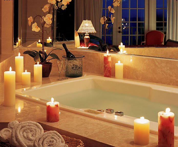 lit candles for spa style bathroom decoration