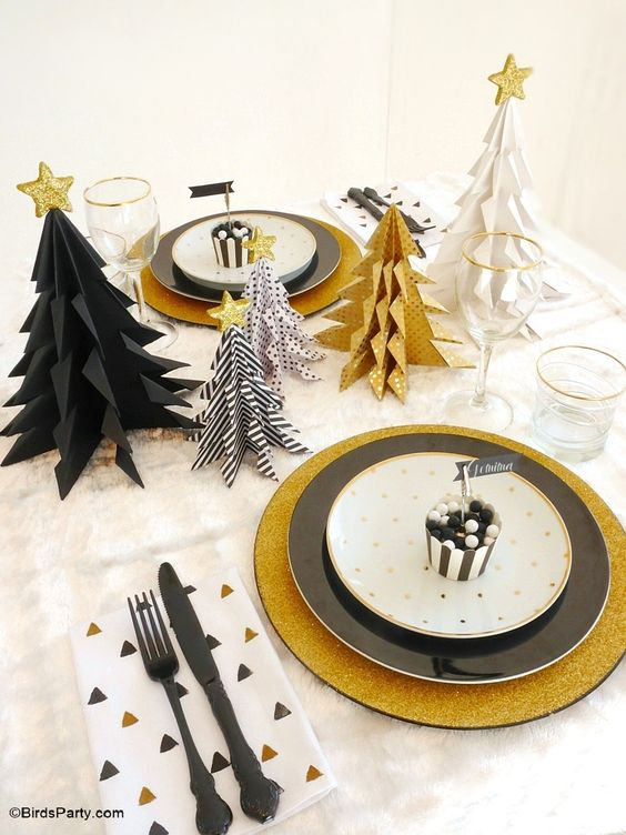 black and gold christmas table setting idea