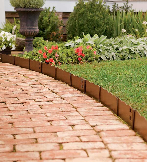 Short Scalloped Copper Edge Along Brick Path #lawnedging #lawnedgingideas #landscaping #gardening #gardens #gardenideas #gardeninigtips #decorhomeideas