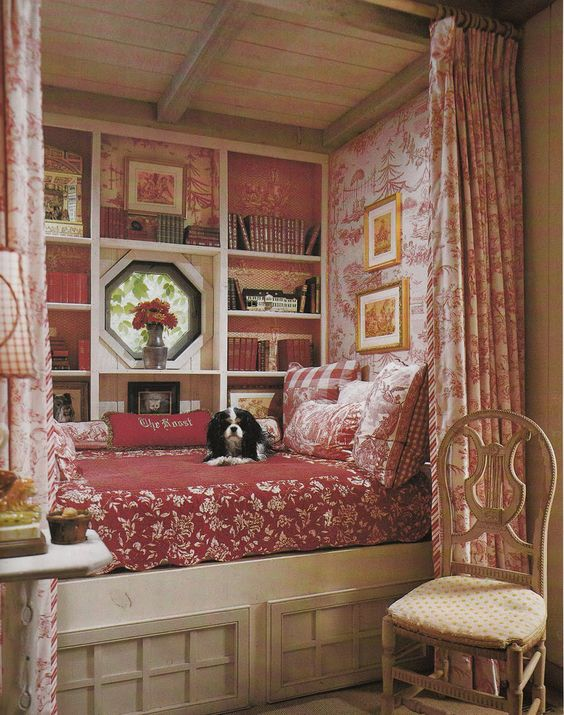 French country reading nook in red and floral motives