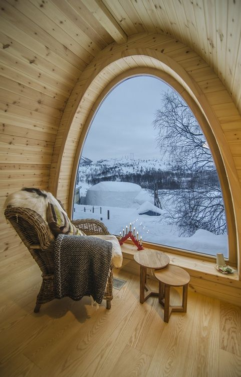 Reading nook in a mountain cabin, log decor