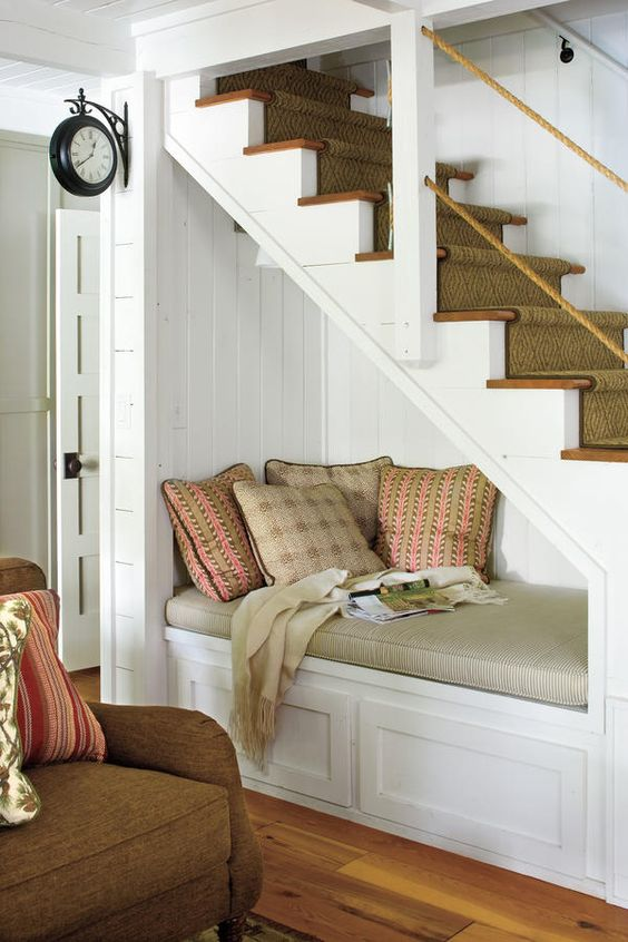 Fabulous use of space under stairs, create a reading nook