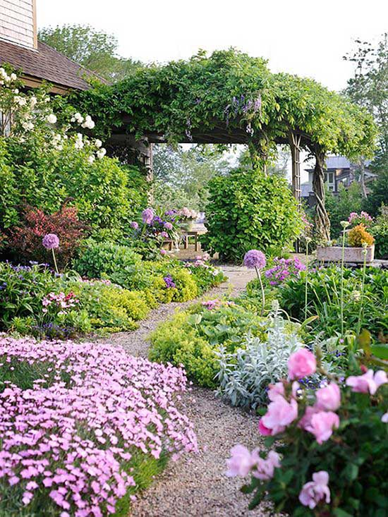 Flower bed around pathway with flowers and pebbles #flowerbed #gardens #decorhomeideas
