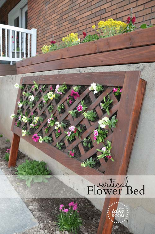 Vertical flower bed from wooden frame #flowerbed #gardens #decorhomeideas