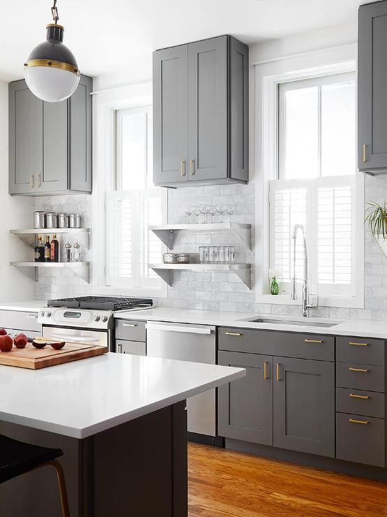 Charcoal gray kitchen cabinets with natural brass pulls #kitchen #graycabinets #graypaint #graykitchencabinets #homedecor #decoratingideas #decorhomeideas