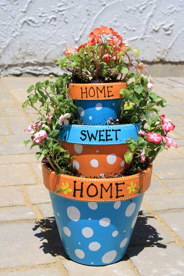 Colorful home sweet home tiered flower pot idea. #flowerpot #planter #gardens #gardenideas #gardeningtips #decorhomeideas