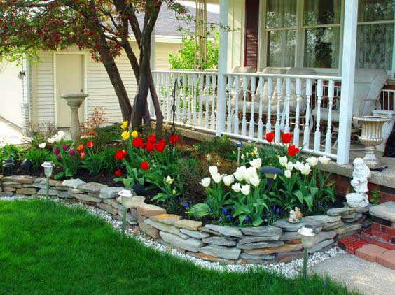Backyard garden edging with small flowers and tulips. #gardens #gardening #gardenideas #gardeningtips #decorhomeideas
