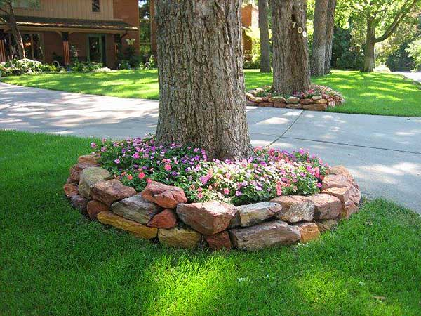 Raised flower bed idea with rocks and stones #flowerbed #flowerpot #planter #gardens #gardenideas #gardeningtips #decorhomeideas