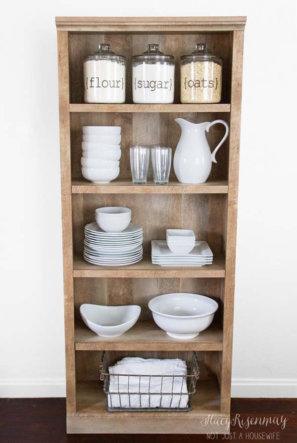 Wooden bookshelf turned into farmhouse kitchen storage #farmhouse #farmhousedecor #storage #organization #farmhousestorage #decorhomeideas
