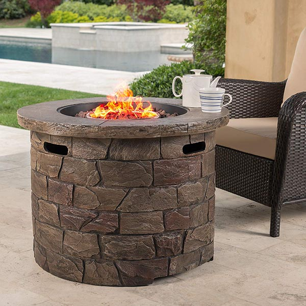 Round stone gas fire pit #firepit #gasfirepit #propanefirepit #firepitdesign #decorhomeideas