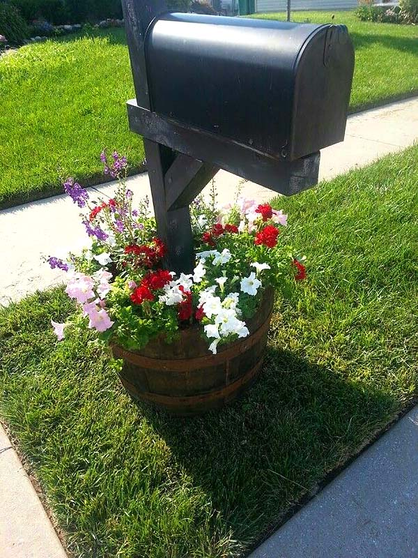 Whisky barrel diy flower bed around mailbox #flowerbed #mailbox #garden #curbappeal #flowers #decorhomeideas