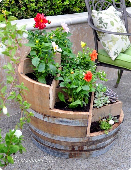 Cut out wine barrel flower planter #diy #winebarrel #flowerplanter #repurpose #decorhomeideas
