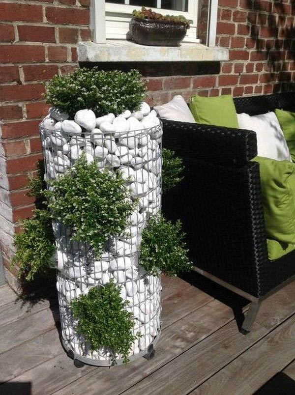 Gabion planter with white pebbles #gabion #gabionplanter #flowerplanter #gardenideas #decorhomeideas