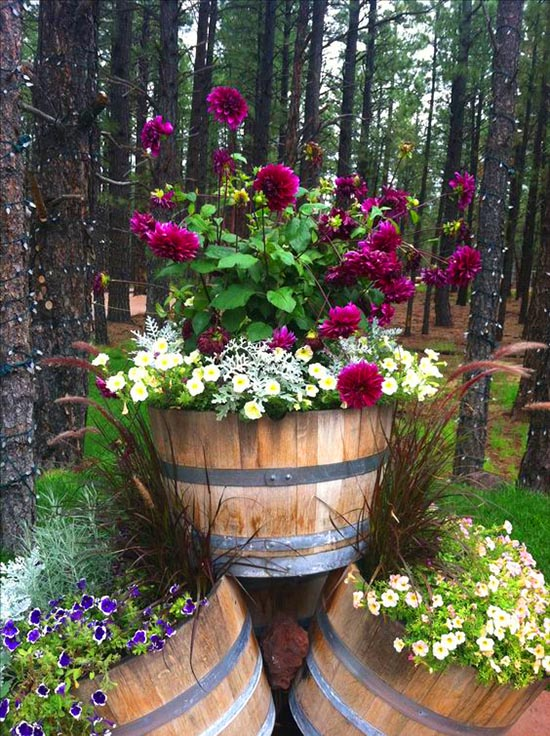Pyramid of wine barrel planters #diy #winebarrel #flowerplanter #repurpose #decorhomeideas