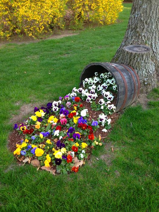 Spilled flower wine barrel planter #diy #winebarrel #flowerplanter #repurpose #decorhomeideas