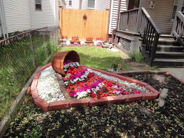 Wine barrel brick flower bed #diy #winebarrel #flowerplanter #repurpose #decorhomeideas