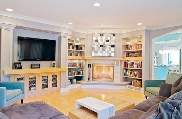 Corner fireplace with bookshelves on each side #fireplace #fireplaceideas #corner #decorhomeideas