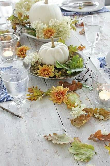 Fall leaves and pumpkin centerpiece #pumpkindecor #centerpiece #falldecor #decorhomeideas