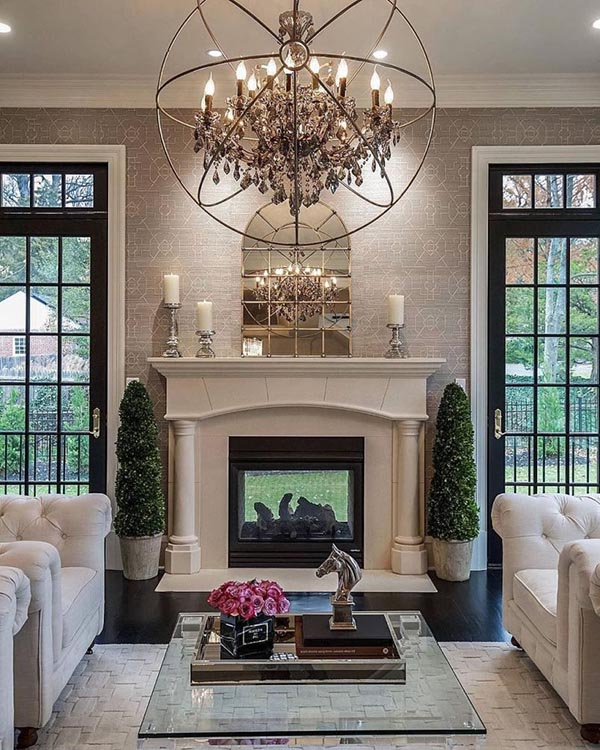 Fireplace mantel with big glass doors and windows on each side #fireplacemantel #fireplace #mantel #homedecor #decorhomeideas