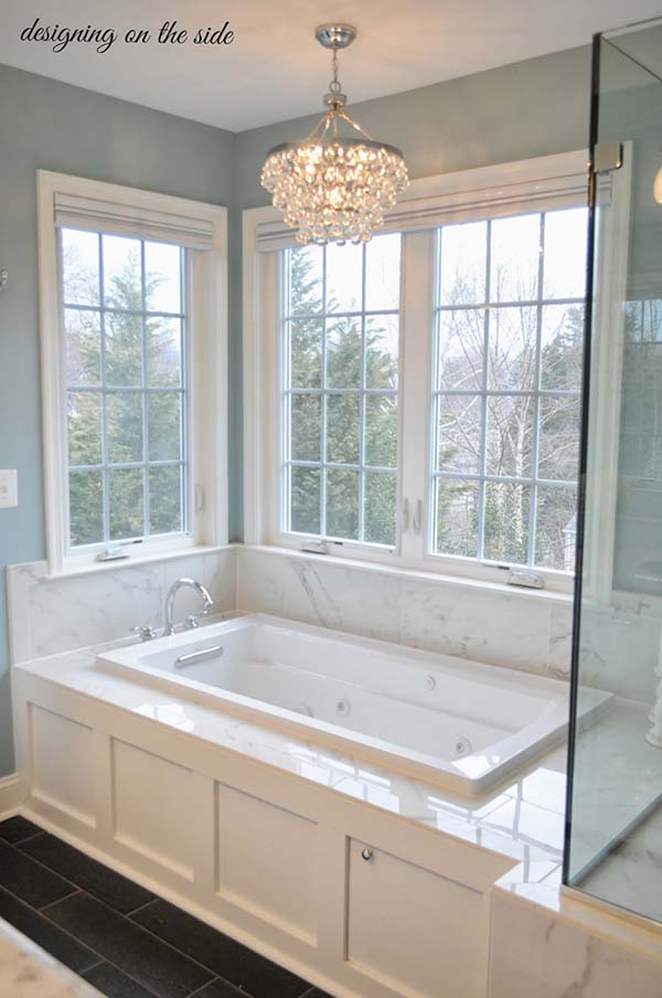 Bathroom tub with big windows surround