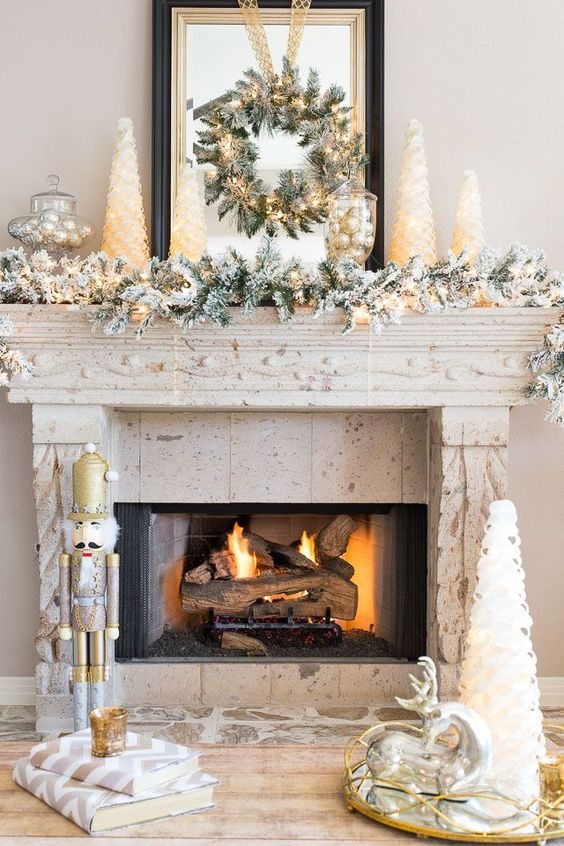 Fireplace Mantel Decorated For Christmas In Gold And Silver