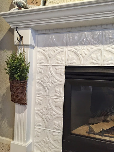Tin Tile Fireplace Makeover #fireplace #fireplacedesign #tile #fireplacetile #decorhomeideas