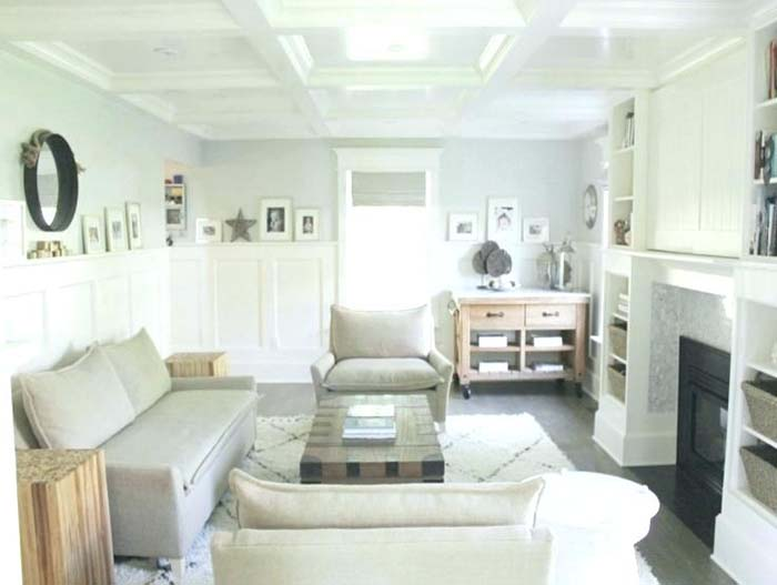 All White Living Room With Wainscoting Wall