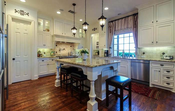 Antique White Kitchen Cabinets Paired With Dark Floor