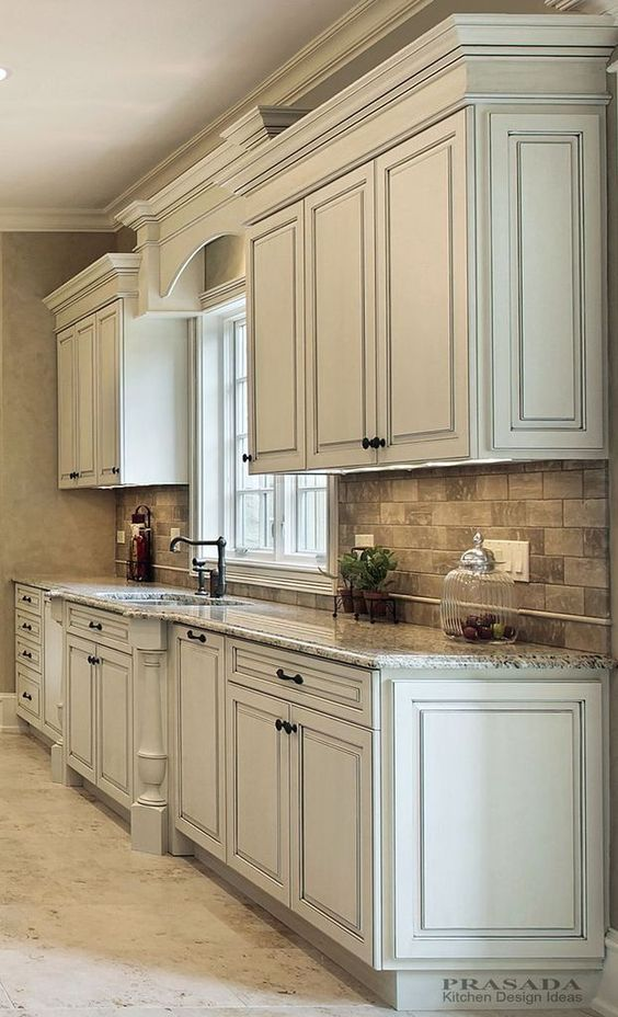 Antique White Kitchen Cabinets With Dark Countertop