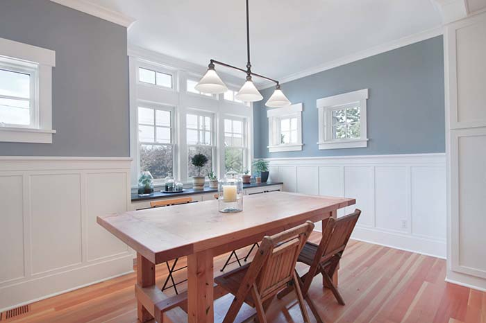 Bright Dining Room With Wainscoting Wall