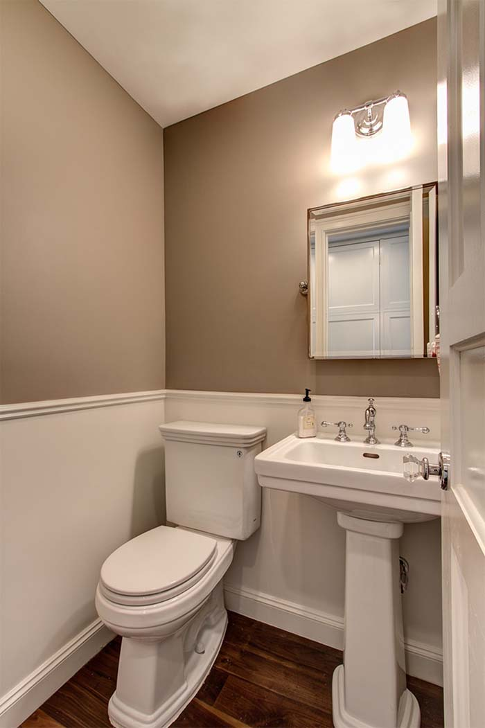 Brown Painted Bathroom With Wainscoting Design
