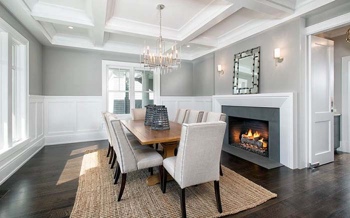Dining Room With Fireplace and Winescoting
