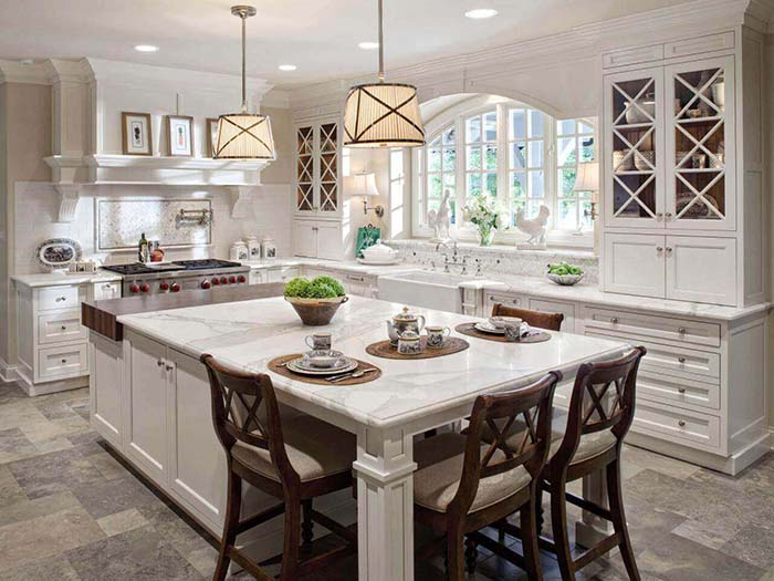 Luxury Antique White Kitchen With Island and wooden chairs