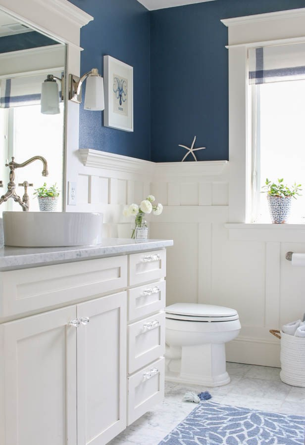 Navy Blue Bathroom With Wainscoting Wall