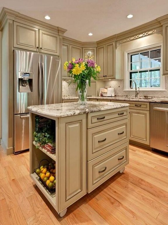 Traditional Kitchen With White antique cabinets and stainless steel appliances