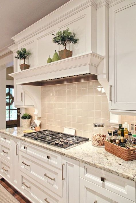 Traditional White Kitchen Cabinets paired with granite countertops and a light grey tile backsplash