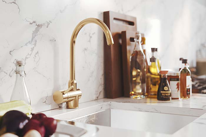 Brass Faucet Incorporated In Blue Kitchen Design